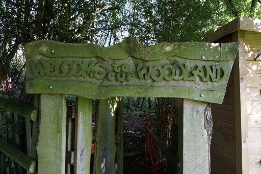 Carved wooden entrance to the Woodland Area